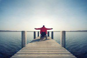 man in wheelchair on dock