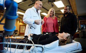 Neurophysiologist Susan Harkema (standing, centre) with study participant Stefanie Putnam in 2017.Credit: University of Louisville
